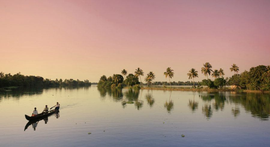Explore the backwaters at dusk during your Kerala tour