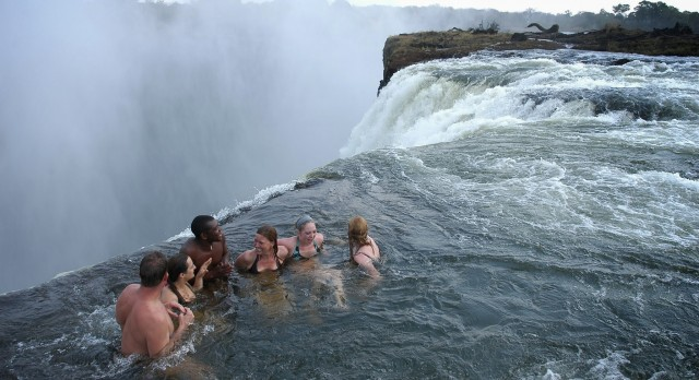 Swimming in the Devil's Pool of Zambezi at Victoria Falls in Africa.